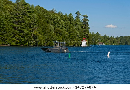 Lighthouse and a boat - stock photo