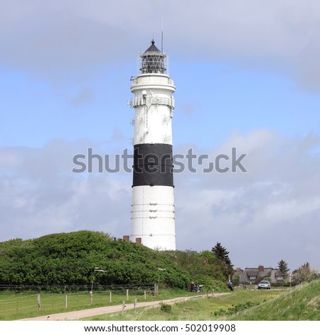 Lighthouse and a Bronze Age burial mound on the island of Sylt, Germany