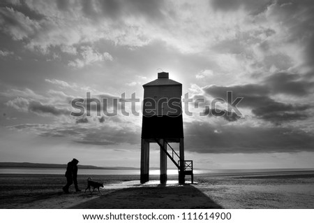Lighthouse and dog walkers