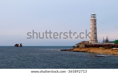 lighthouse and flooded  ship