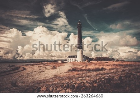 Lighthouse and keeper's house near beautiful bay  - stock photo