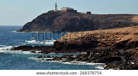 Lighthouse and rocky coves, tip of Arinaga, Gran canaria island - stock photo
