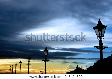 lighthouse and row of vintage lamps on the promenade in Youghal county Cork Ireland - stock photo