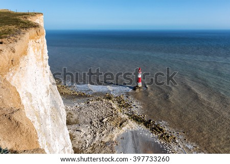 Lighthouse and steep chalk cliffs at Beachy Head, East Sussex, United Kingdom - stock photo