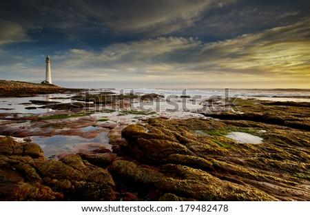 lighthouse and sunset  - stock photo
