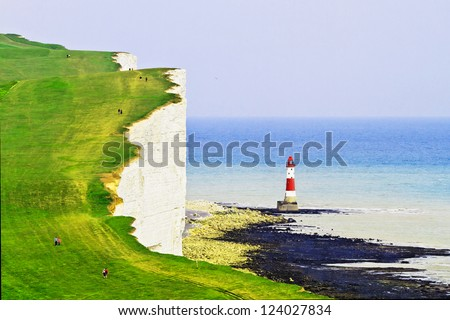 Lighthouse and the white cliffs of south England - stock photo