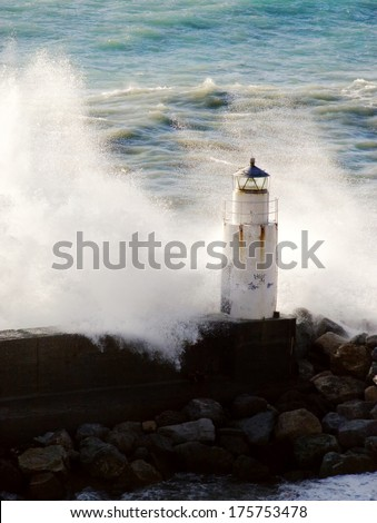 lighthouse and wave.