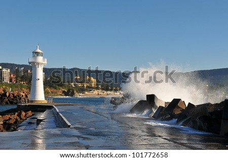Lighthouse and waves - stock photo