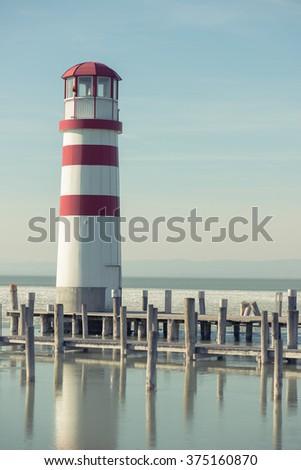 Lighthouse and wooden pier, Podersdorf, Austria - stock photo