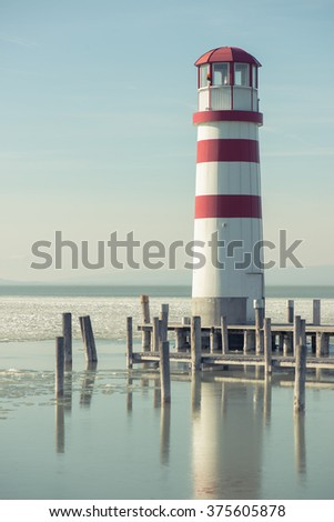 Lighthouse and wooden pier, Podersdorf, Austria - stock photo