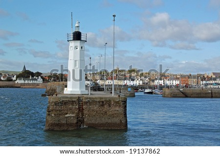 lighthouse at anstruther harbour in scotland - stock photo