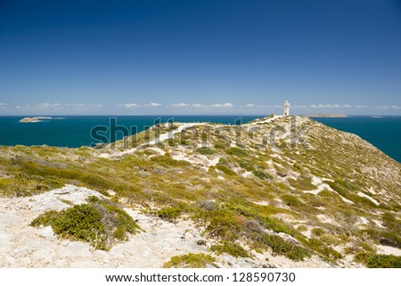 Lighthouse at Cape Spencer, South Australia, perched high above the ocean - stock photo