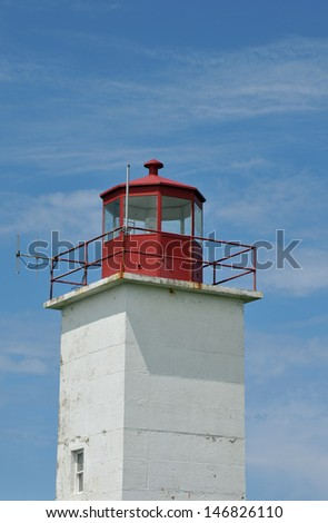 Lighthouse at Cape St. Mary, Nova Scotia, on a summer day - stock photo