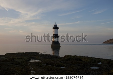 lighthouse at dusk, penmon point, anglsey