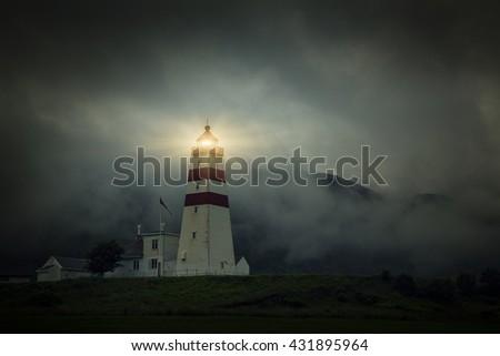 Lighthouse at foggy day, Fishing Village In Godoya Island - Giske, Romsdal county, Norway. - stock photo