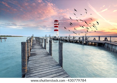 lighthouse at Lake Neusiedl at sunset near Podersdorf, Burgenland, Austria                                - stock photo