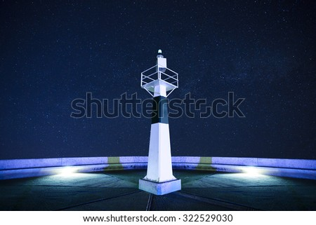 Lighthouse at starry night - stock photo