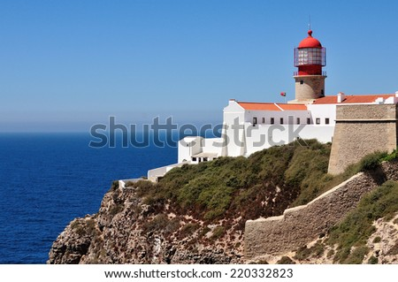 Lighthouse at the background of clear blue sky and deep blue ocean