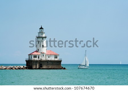 Lighthouse at the entrance to the Chicago harbor Lake Michigan - stock photo