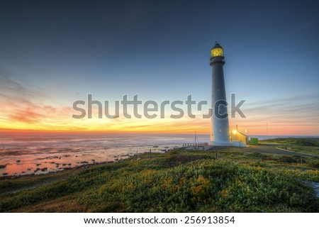 Lighthouse at Twilight Taken in Cape Town, South Africa. Slangkop Kommetjie Lighthouse. - stock photo