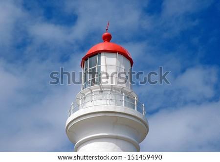 Lighthouse Closeup with Blue Sky - stock photo