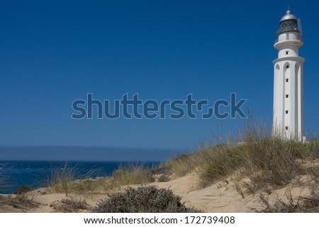 lighthouse conil spain in daylight - stock photo