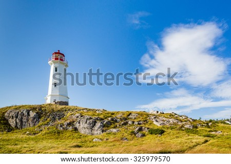 Lighthouse guarding coast of Sydney, Nova Scotia - stock photo