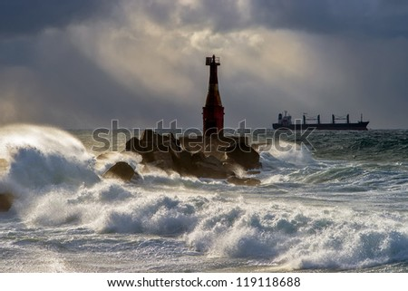 Lighthouse in a storm. Kholmsk. - stock photo