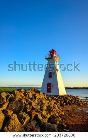 Lighthouse in Charlottetown at sunset - stock photo