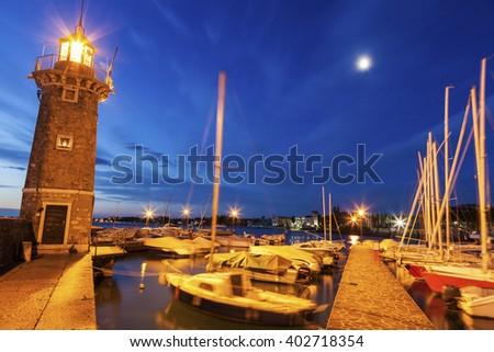 Lighthouse in Desenzano del Garda. Desenzano del Garda, Lombardy, Italy. - stock photo
