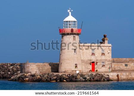 Lighthouse in Ireland - stock photo