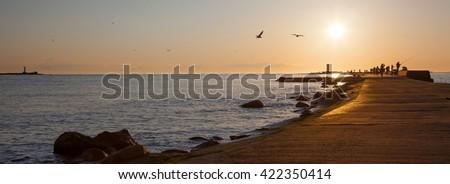 Lighthouse in Mangali on the baltic sea. Riga. Latvia. Walkway. Landscape. Panorama. - stock photo