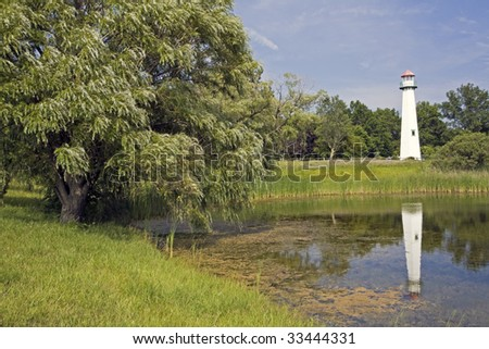 Lighthouse in Michigan - summer time. - stock photo