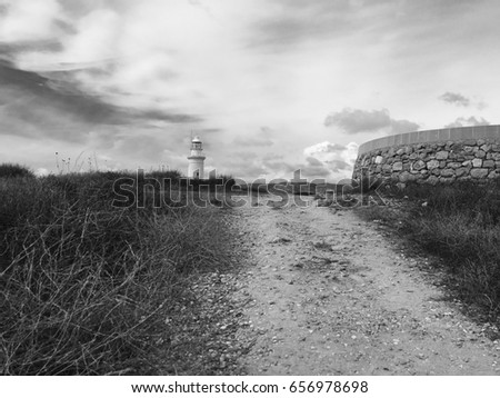 Lighthouse in middle of Mediterranean landscape