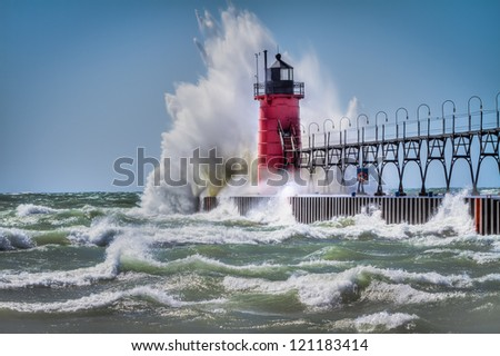 Lighthouse in South Haven Michigan during wind storm - stock photo