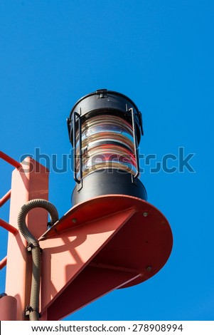 Lighthouse in the harbor of Hamburg. The Signal Fire guides the ships and boats in the harbor - stock photo