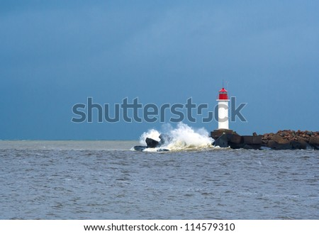 Lighthouse in the storm - stock photo