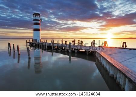 Lighthouse - Lake in Austria - stock photo
