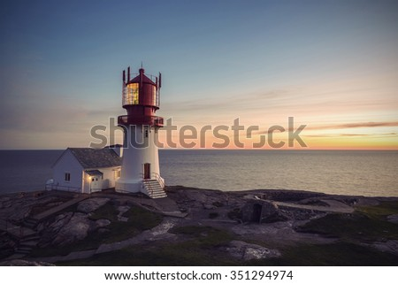 Lighthouse Lindesnes Fyr at sunset on most southern point of Norway, Europe, Vintage filtered style - stock photo