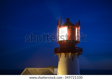 Lighthouse Lindesnes Fyr shines at night on most southern point of Norway, Europe - stock photo
