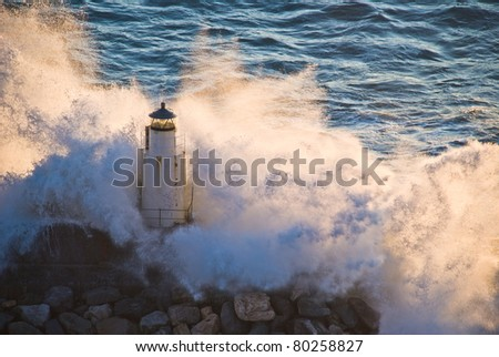 Lighthouse of Camogli during a sea storm