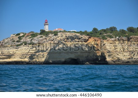 Lighthouse of Carvoeiro seen from a tour boat in Algarve, Portugal. Travel and vacation destinations - stock photo
