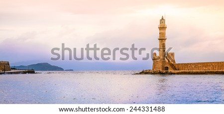 Lighthouse of Chania, Crete, Greece. Panoramic view of port di Chania in sunset. - stock photo