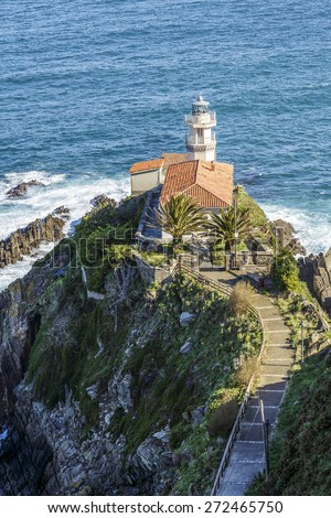 Lighthouse of Cudillero, Asturias, Northern Spain. Vertical shot - stock photo