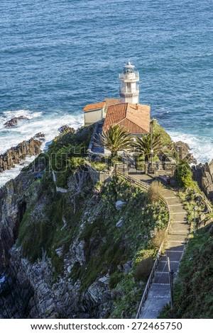 Lighthouse of Cudillero, Asturias, Northern Spain. Vertical shot - stock photo