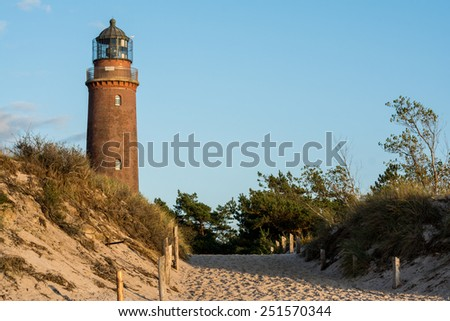 lighthouse of Darss Peninsula at sunset - stock photo