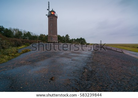 Lighthouse of Sankt Peter Ording Boehl on a rainy morning, North Sea in Germany