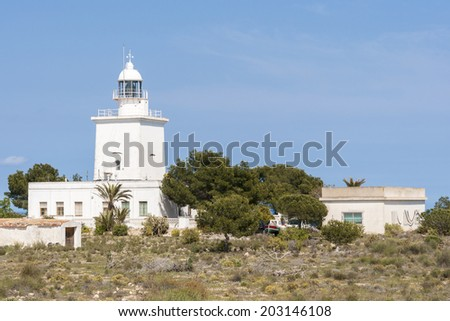 Lighthouse of Santa Pola, Alicante, Spain.  It is a coastal town located in the comarca of Baix Vinalopo, in the Valencian Community, Alicante, Spain, by de Mediterranean
