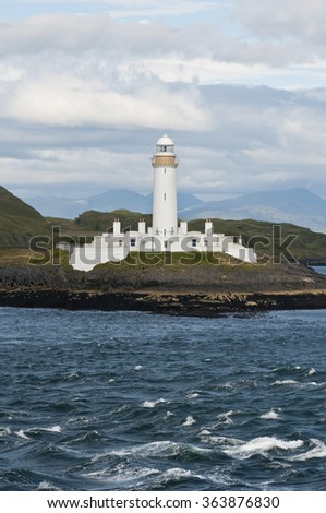 Lighthouse of Scotland seen from a boat - stock photo