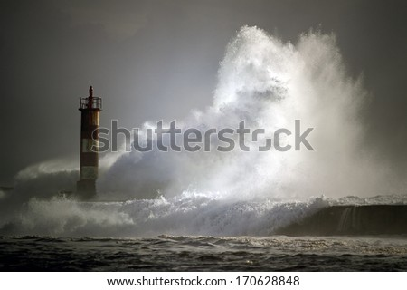 Lighthouse of the river Ave entrance in a stormy evening, Vila do Conde, north of Portugal - stock photo